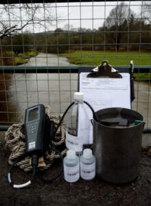 Image shows the equipment which is used for taking a water sample for water quality analysis.