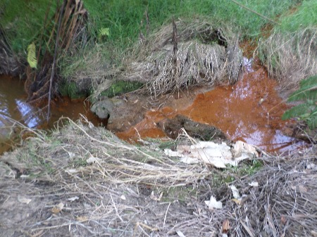 Toxic sewer leachate illustrated to show the effects of leachate on groundwater and surface water.